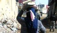 Cizreli Kadın Kur'an-ı Başının Üstünde Taşıdı