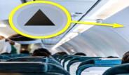 Uçak Kabinlerinin Duvarındaki Siyah Üçgen Ne İşe Yarıyor?