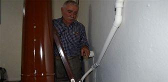 Mucit öğretmen, sobaya döşediği tesisat ile tüm evini ısıtıyor