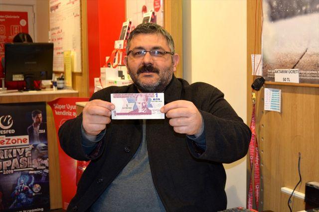 15 yıldır sakladığı kesim hatalı 1 YTL'si için 100 bin lira istiyor