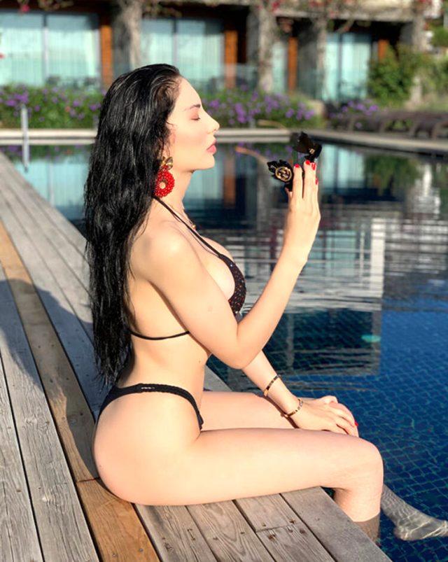 Tatil sezonunu açan Tuğçe Aral, bikinili pozlarıyla nefes kesti