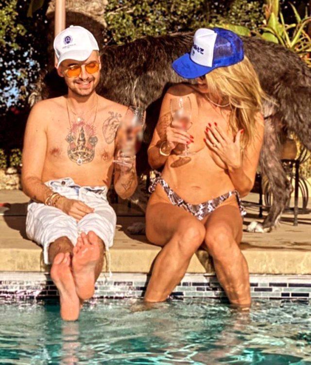 Dünyaca ünlü model Heidi Klum, havuz başında üstsüz güneşlendi