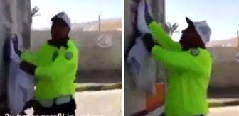 Fethi Sekin: Çevirme yapan trafik polisi, aracın arkasındaki şehitlerin fotoğraflarını elleriyle temizledi