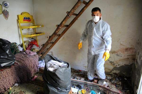 Evinden 2 kamyon çöp çıkan yaşlı kadının koronavirüs testi pozitif çıktı