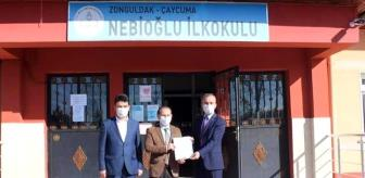 İsmail Çelebi: İlçe Milli Eğitim Müdürü Baş, okullara belgelerini verdi