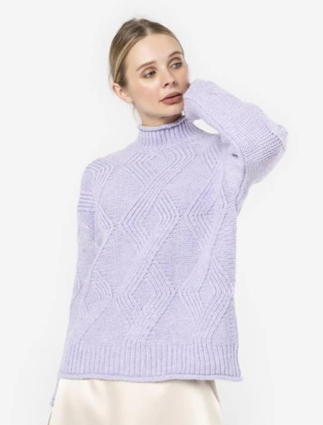 Tesettür giyimde dikkat çeken triko tunik modelleri