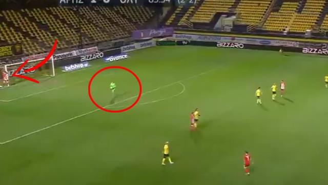 Awake football player hiding next to the goal post caught the goalkeeper by surprise