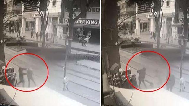 Öfkeli adam yerden aldığı şişeyle birlikte yürüdüğü genci öldüresiye dövdü