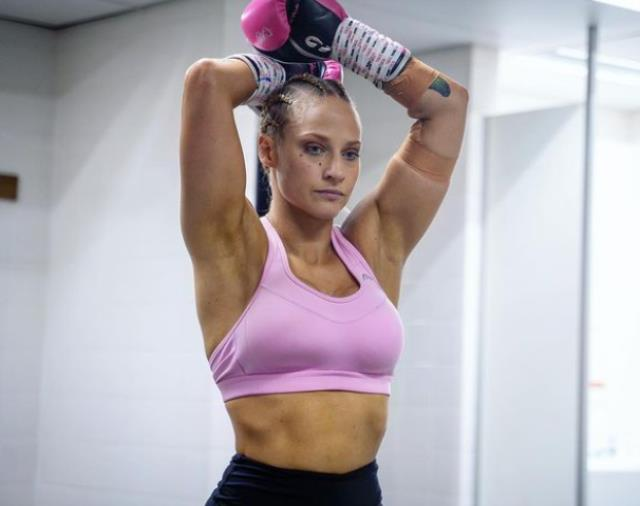 Australian female boxer gets rich by selling the socks she wears to her male fans
