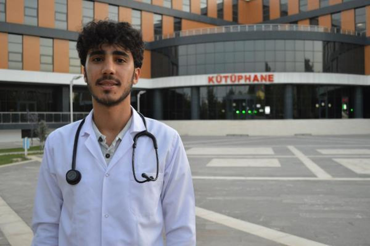 A medical student studies in the library where he was a worker in construction once