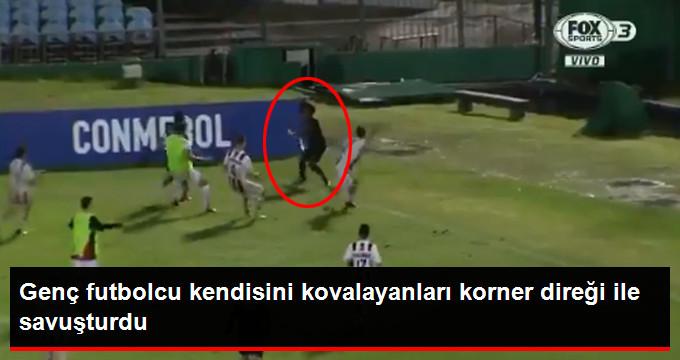 Genç futbolcu kendisini kovalayanları korner direği ile savuşturdu