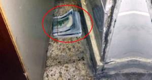 Polisi görünce panikleyen doktor, 3 bin doları dolabın arkasına attı