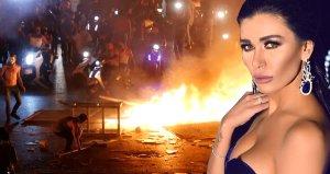 Lübnanlı ünlü oyuncu Nadine Al Rassi vergi protestolarına katıldı, lastik yaktı