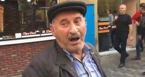Azerbaycanda yolsuzluk protestosu sırasında röportaj veren bir eylemcinin gözaltına alınma anı, sosyal medyada gündem oldu