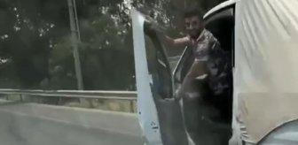 Seyir halindeki aracın direksiyonunu bırakıp kapıdan sarkan sürücüye ceza yağdı