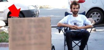 Dert dinleyerek Türkiye'yi dolaşan gezgin, kartona yazdığını başarabilene 100 TL veriyor