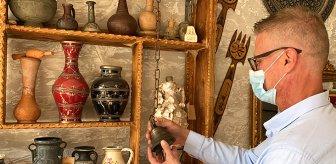 Hurdacının getirdiği çanı zımparalayan antikacı, gördüğü manzara karşısında şaşırıp kaldı