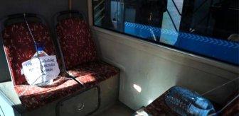 Otobüs şoföründen ilginç korona önlemi: Yasaklı koltuklara 5 litrelik bidon bağladı
