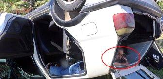 Ters dönen aracın içinde sıkışsa da cep telefonunu bir an olsun elinden bırakmadı